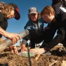 Russell Ranch director Kate Scow works with students to collect soil samples for testing. Photo from UC Davis Science and Climate website.